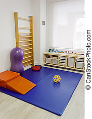 Empty physiotherapy clinic with equipment for kids rehabilitation