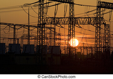 Solar energy versus electrical energy - sunset and network system of high voltage