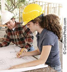 Engineering Student Marking Blueprints