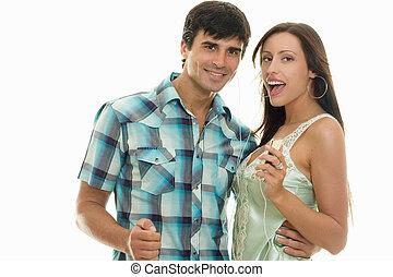 Guy and girl enjoying music together