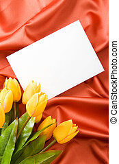 Envelope and flowers on the satin background