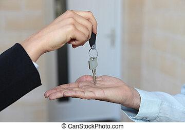 Estate-agent handing over house keys