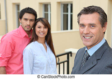 Estate agent with young couple
