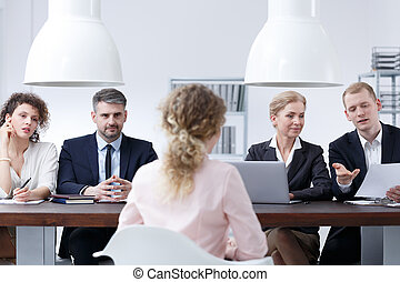 Examination board discussing resume