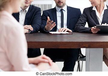 Examination board member asking question