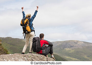 Excited couple reaching the top