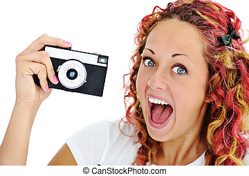 Excited girl with retro camera