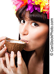 Face of a young woman drink coconut milk