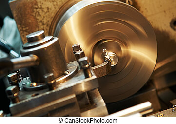 facing metal blank by cutter on lathe