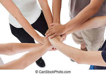Close-up high angle view of a happy family holding hands