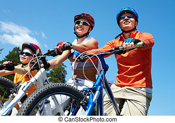 Family on bicycles