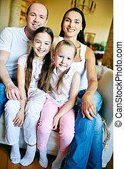 Family on sofa