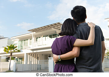 Family with dream house