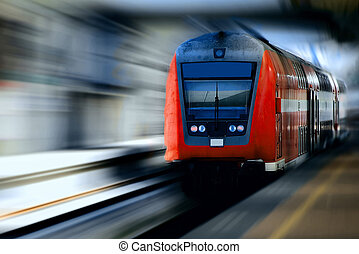 Fast moving red train against a blurred background.