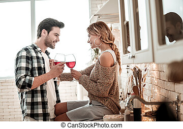 Sweet young long-haired woman in white socks and her dark-haired husband looking excited