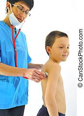 female doctor examining little child boy