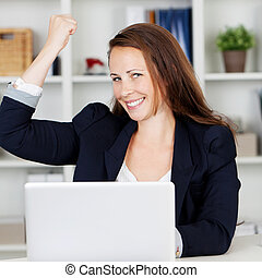 Image of a happy female executive expressing her joy after achieve her targets.
