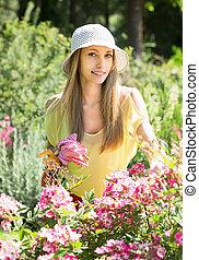 gardener walking near flowering shrubs