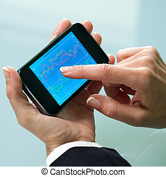 Female hand reviewing information on smart phone.