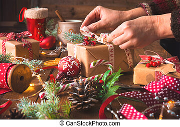 Female hands wrapping christmas holiday handmade presents