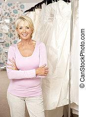 Female sales assistant in bridalwear store