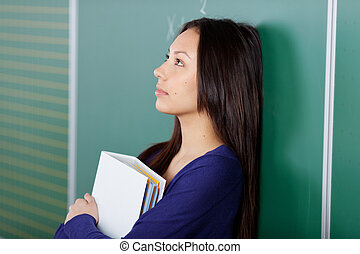female student in thoughts