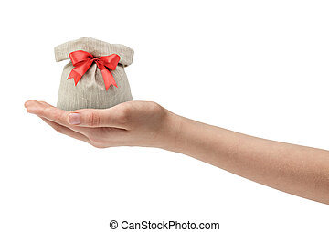 female teen hand holding sack back with present