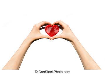 female teen hands holding heart