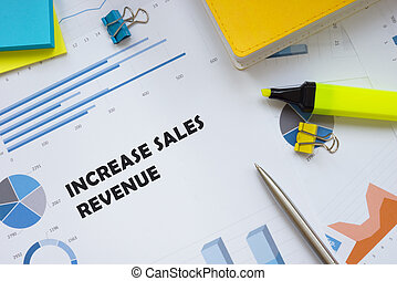 Financial concept about Increase Sales Revenue with inscription on the sheet.