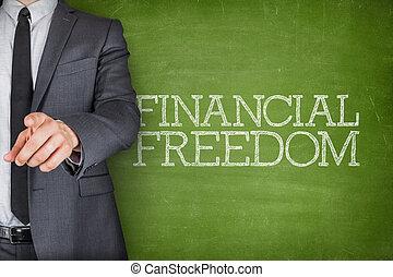 Financial freedom on blackboard with businessman