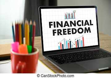 FINANCIAL FREEDOM open book on table and coffee Business freedom