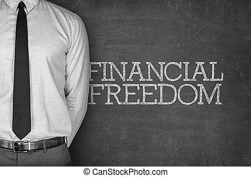 Financial freedom text on blackboard