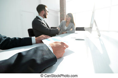 financial graph in hands of the businessman. business background