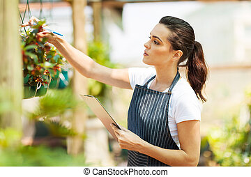 florist checking flowers condition