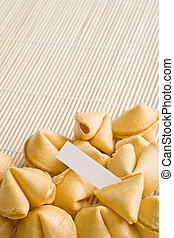 fortune cookie - single cookie cracked open with paper to insert your own text, entire text area in clean focus