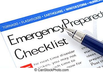 "fountain pen lying on "" Emergency Preparedness Checklist "" form"