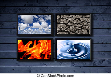 Big panel of TV�s on a wood blue wall showing a presentation with the earth elements