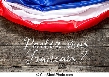 France Flag on wooden Table with french Text, Concept Language and Communication