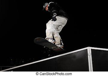 freestyle snowboarder jump