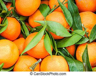 Bunch of fresh mandarin oranges on market