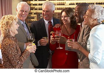Friends Socializing At A Bar