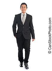 Full body Asian business people walking