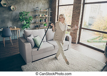 Full length body size view of her she nice attractive healthy lovely cheerful gray-haired granny dancing with cane having fun at industrial brick loft modern style interior house apartment