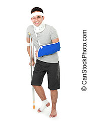 full length portrait of injured young man wear arm sling and crutch