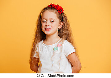 Funny girl child standing isolated