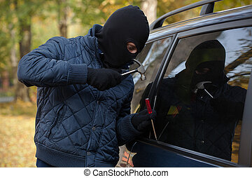 Gangster trying to open a car's window