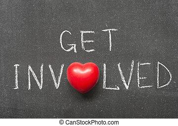 get involved phrase handwritten on school blackboard with heart symbol instead of O