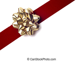 Gold bow on red ribbon isolated against white. Gift wrapping materials