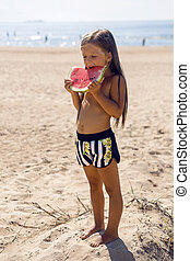 girl child standing on the beach