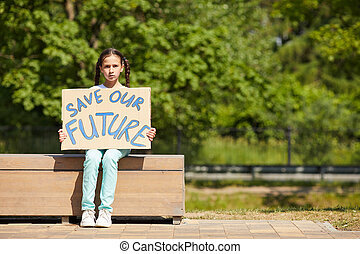Girl Holding Save Our Future Sign